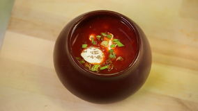 Red soup borsch with sourcream being prepaired and served at the restaurant kitchen stock video footage