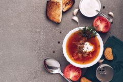 Red soup borsch in white bowl on the gray surface, top view. royalty free stock photography