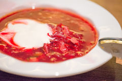 Red soup with sour cream. Soup with sour cream in a dish close up stock photos