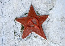Red soviet star on cracked wall Royalty Free Stock Images