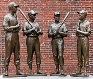 The Red Sox Team Players. The four famous Red Sox Team Players Ted Williams, Bobby Doerr, Johnny Pesky, and Dom Dimaggio in front of the Fenway Park Stadium in Stock Photo