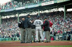 Red Sox and Yankees coaches meet at homeplate before Game 3 of the 2003 ALCS. Image taken from a color negative stock photos