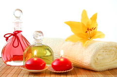 Red spa. Decoration with massage oil bottle and candles Stock Photo