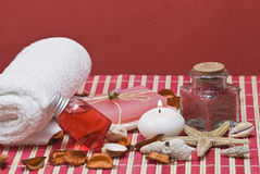 Red spa. Red spa background with some objects on a red bamboo mat Stock Image