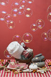 Red spa with soap bubbles. Spa background in red with some hygiene items and bubbles Stock Photos