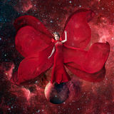 Red space queen. Beautiful woman in a fluttering Stock Photography
