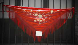 Red spanish shawl to sell in a window. Andalusia Stock Image