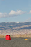 Red spare gas tank. Red spare / reserve gas tank on a remote highway Stock Photography