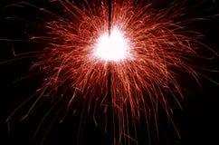 Red Sparkler. An ignited sparkler on a dark background Stock Photography