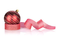 Red sparkling christmas bauble with ribbon. Isolated on white background Stock Photo