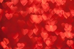 Red Sparkling Defocused Lights of Hearts Background. Valentine`s Day Concept: Red Sparklng Defocused Romantic Background of Lights Hearts Stock Photo