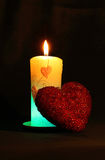 Red sparkling heart with candle Royalty Free Stock Photo