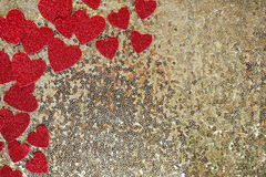 Red Sparkly Heart Confetti Framing Gold Sequin Background Stock Photo
