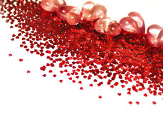 Red sparkly hearts. Red sparkly hearts of different shapes and volumes on a white background royalty free stock photos