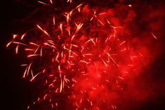 Red sparks into black sky. Red firework display into a black night sky. Low-angle shot Royalty Free Stock Photos