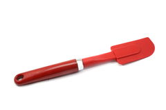 Red Spatula. Red baking spatula displayed on a white background Royalty Free Stock Photo
