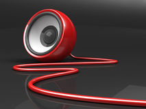Red speaker with cable over grey Royalty Free Stock Photo