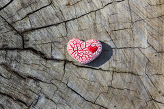 Red Speckled Heart on Wood Stock Images