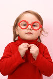 Red spectacles. Small girl in red woman's jacket and red spectacles Royalty Free Stock Images