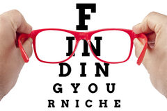 Red spectacles focusing finding your niche. Red spectacles focusing on text finding your niche arranged as eye chart test. Letters outside field of view are stock photography