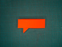 Red Speech Bubble on Cutting Mat Stock Photography