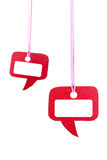 Red speech bubble hanging on white Royalty Free Stock Photo