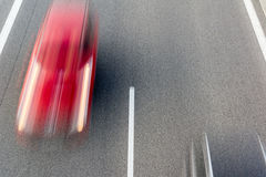 Red speeding car Stock Photo