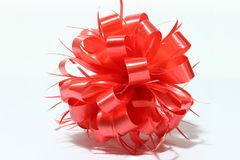 Red sphere new year ribbon on white background. Stock Image