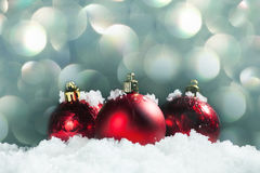 Red sphere in snow. Christmas decoration. Christmas sphere on snow Stock Photography