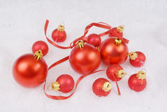 Red spheres with ribbon. On the white fur Stock Photo