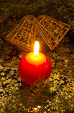 Red, spherical candle and bells Stock Images
