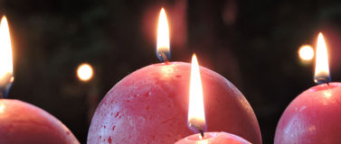 Red spherical christmas candles Stock Photos