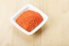 Red spice mixture for fish courses on wood Stock Images