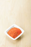 Red spice mixture on wood Stock Images