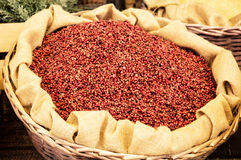 Red spices in the wicker basket Royalty Free Stock Images