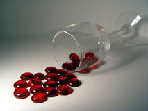 Red Spill. A wine glass spilling beads Royalty Free Stock Images