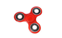 Red spinner stress relieving toy Stock Photo