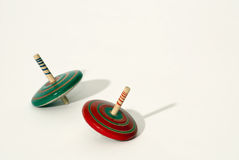 Red spinning top. Spinning top red and green Stock Photography