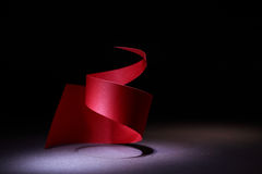 Red Spiral. Abstract composition with red paper spiral on dark background Stock Photography