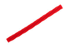 Red spiral licorice stick on a white background Stock Photos