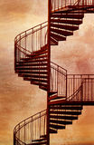 Red spiral staircase. Red metal spiral staircase with grungy Royalty Free Stock Images