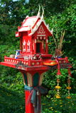Red Spirit House. A traditional Thai Spirit house in red color royalty free stock image