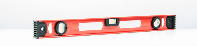 Red spirit level isolated. On over white background Royalty Free Stock Photos