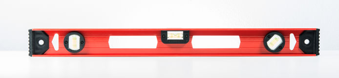 Red spirit level. On over white background Royalty Free Stock Photography