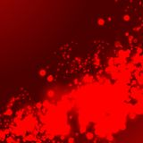 Red splash on dark red background. Royalty Free Stock Photography