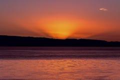 Warm sunrise over the horizon stock photo