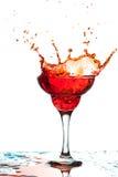 Red splashing cocktail Royalty Free Stock Photo