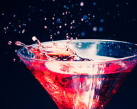 Red splashing cocktail Royalty Free Stock Photo