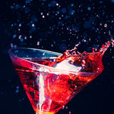 Red splashing cocktail Royalty Free Stock Photos
