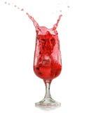Red splashing drink Stock Photos